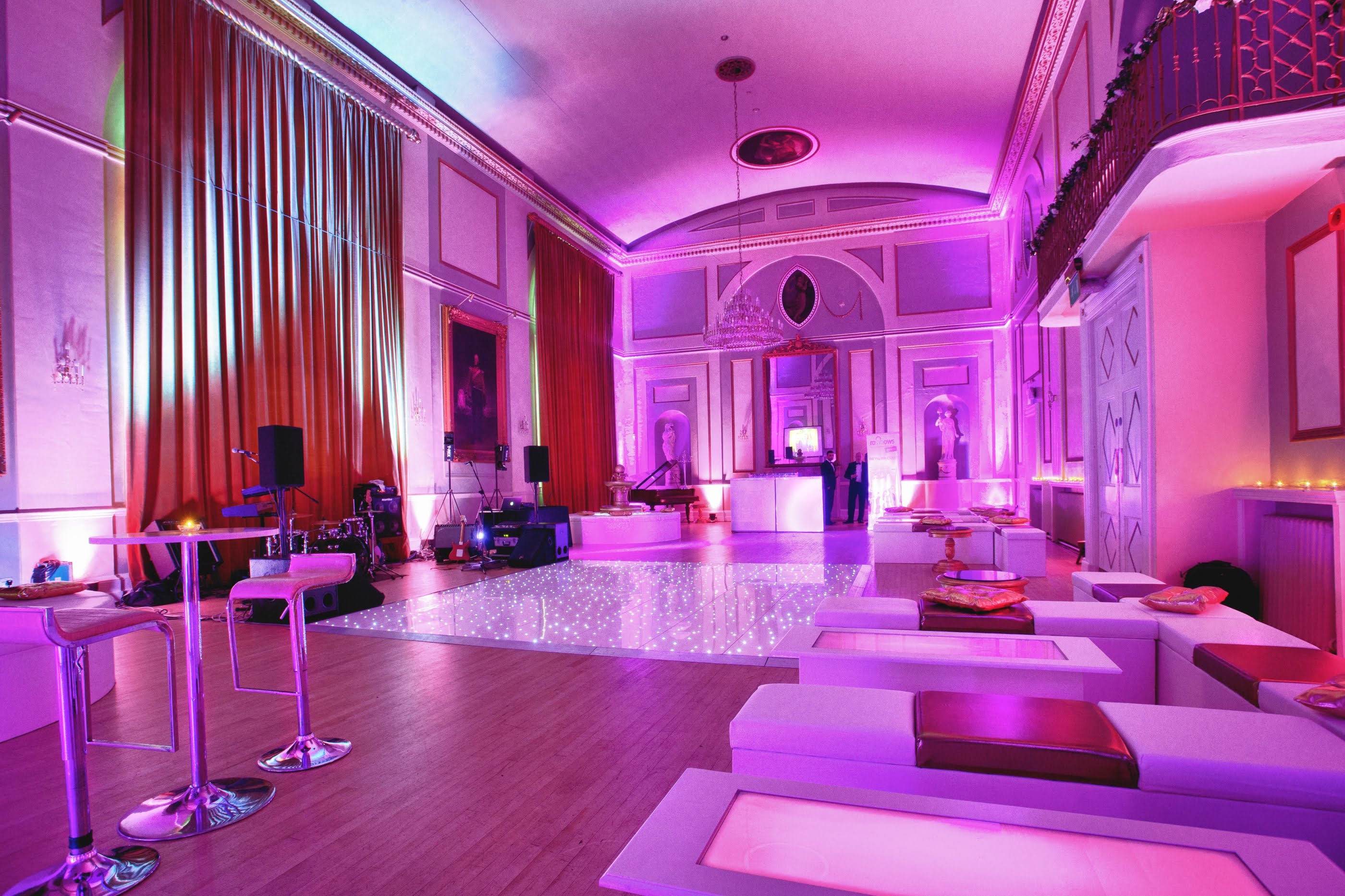 The City Rooms Leicester wedding decor with colours furniture range, uplighting and white LED dance floor