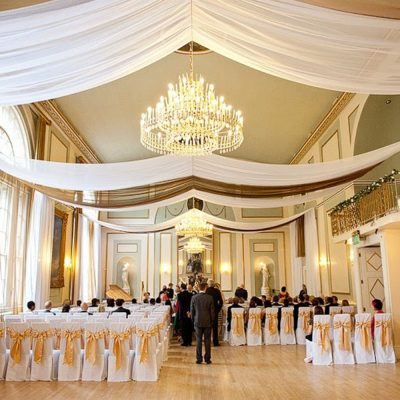 white and gold wedding ceiling drapes