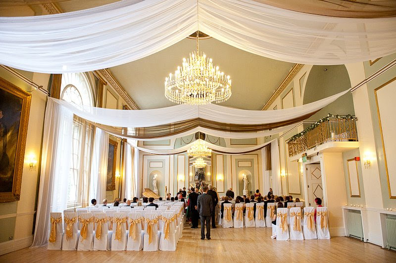 The City Rooms Leicester wedding decor with linear horizontal white and gold ceiling drapes