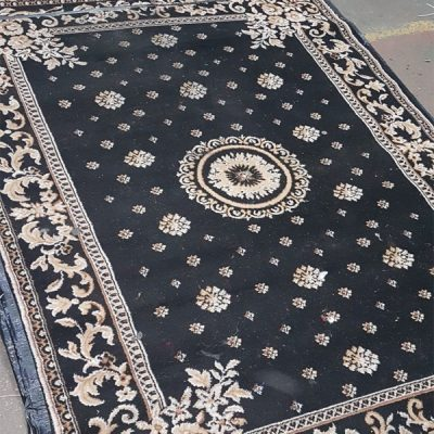 traditional black rug mehndi wedding decor