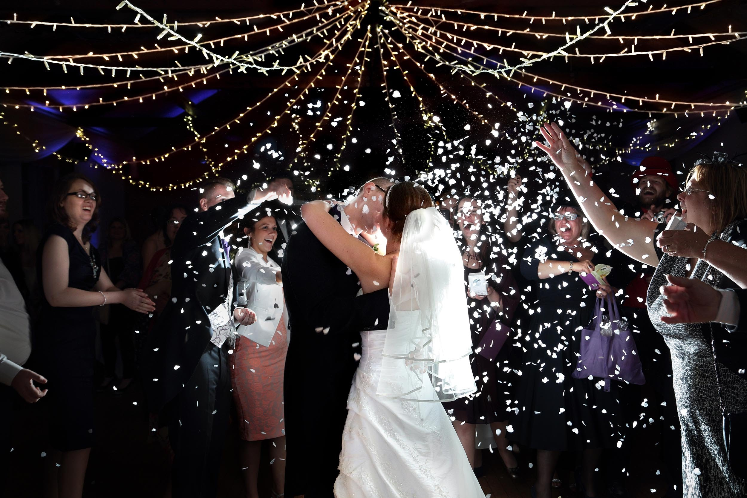 Village hall wedding decor hire with fairy light canopy