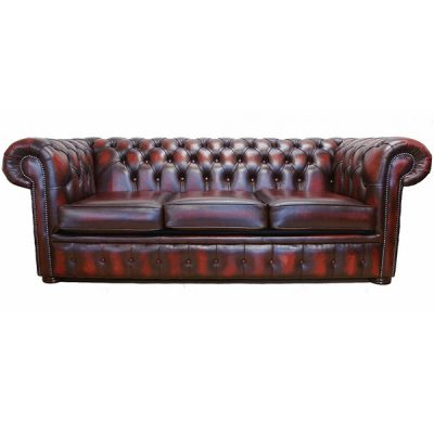 oxblood chesterfield sofa wedding decor