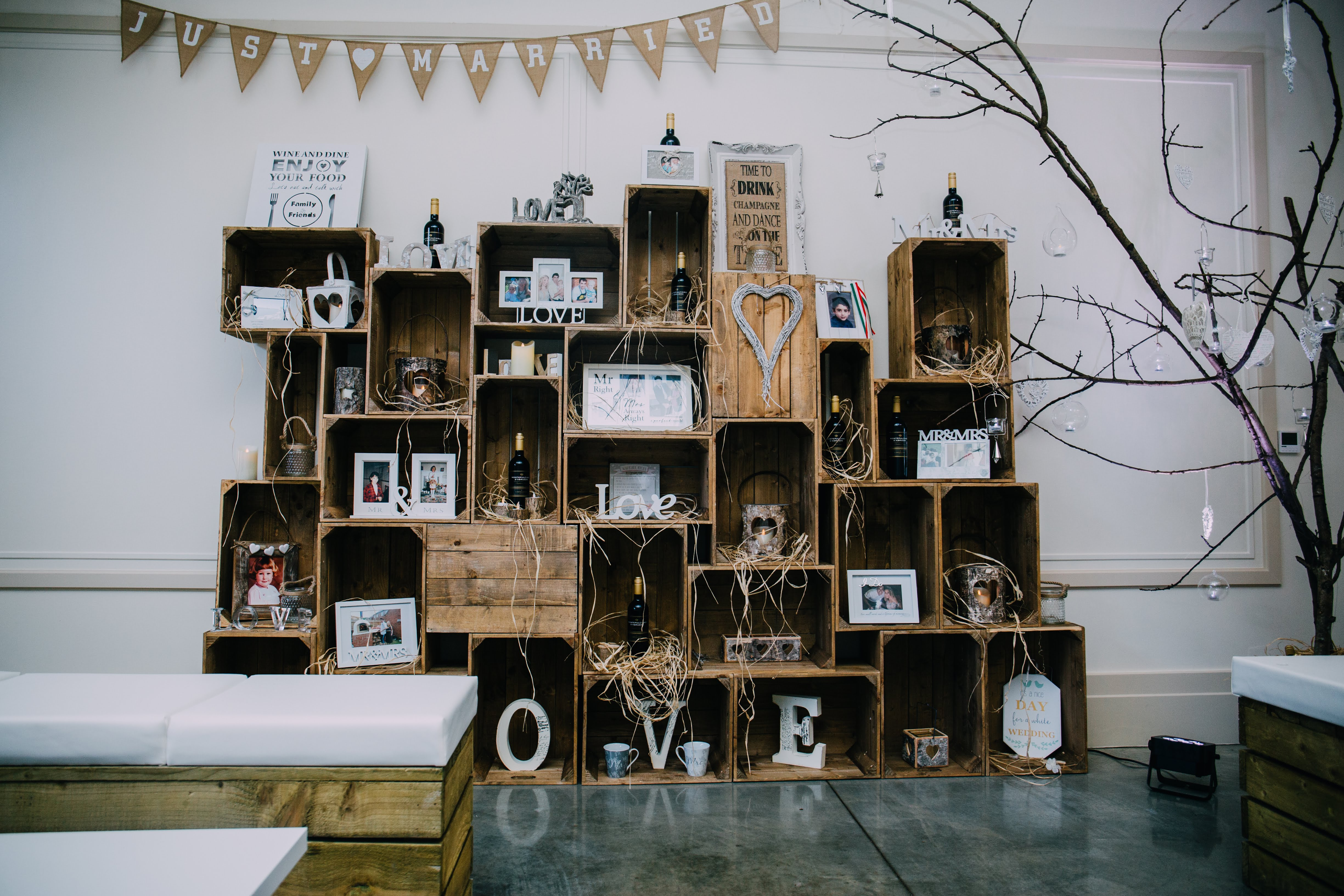 Ladywood Estate wedding decor with rustic furniture hire and apple crate display