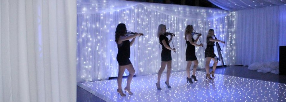 white LED dancefloor with fairy light curtain