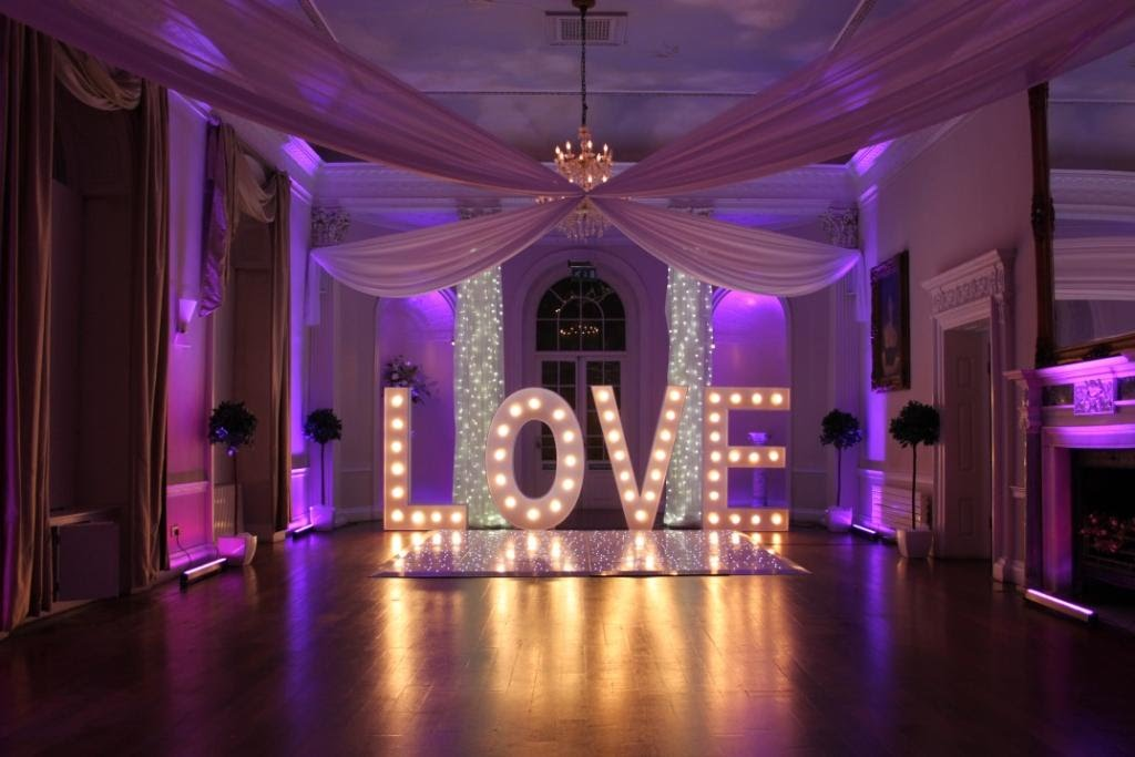 Colwick Hall wedding decor hire with ceiling drape, light up love letters and white LED dance floor