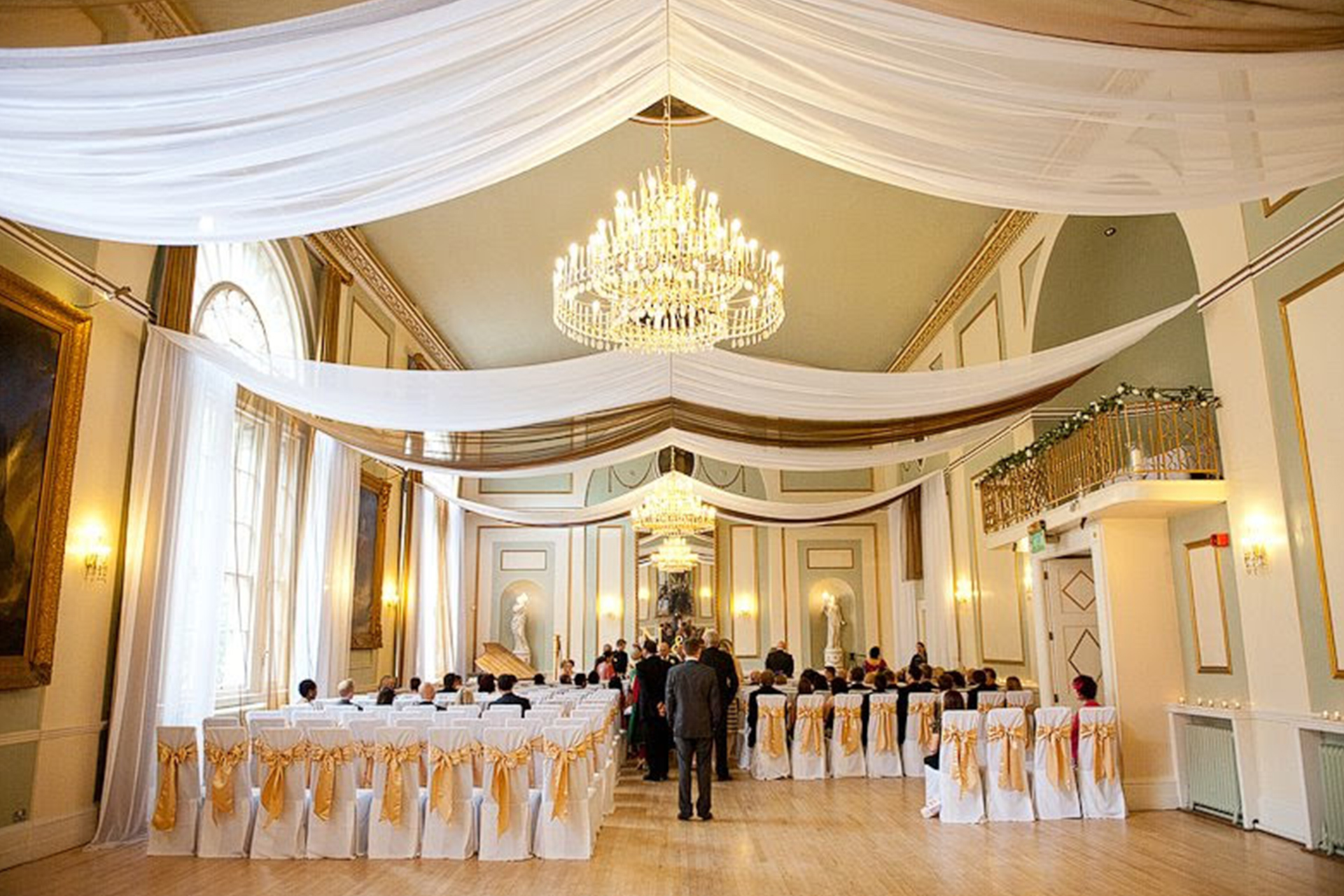 More Weddings white and gold wedding ceiling drapes