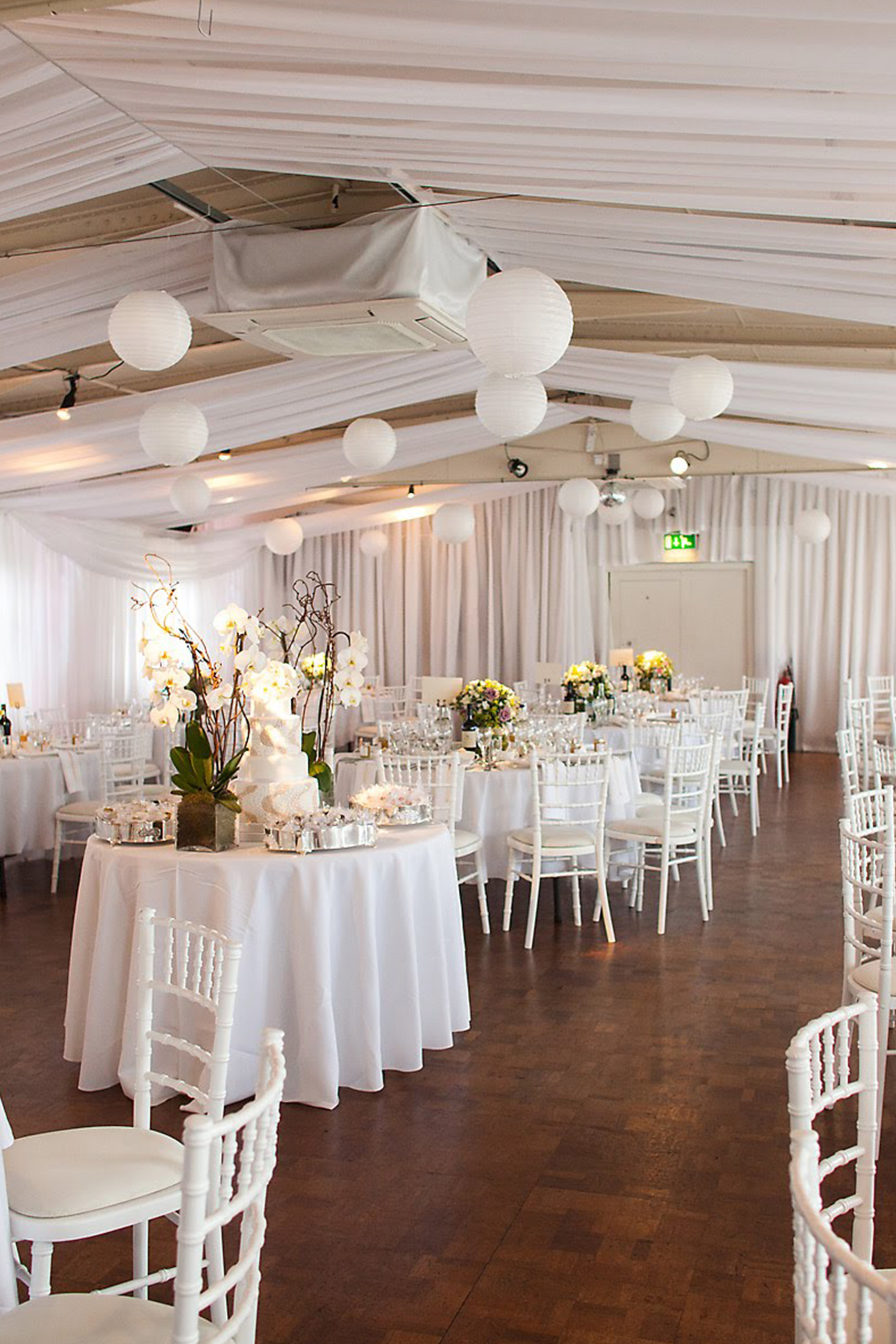 More Weddings wedding ceiling drapes with hanging paper lanterns