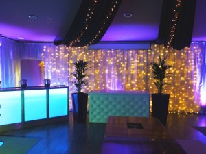 LED Bar and white chesterfield DJ booth
