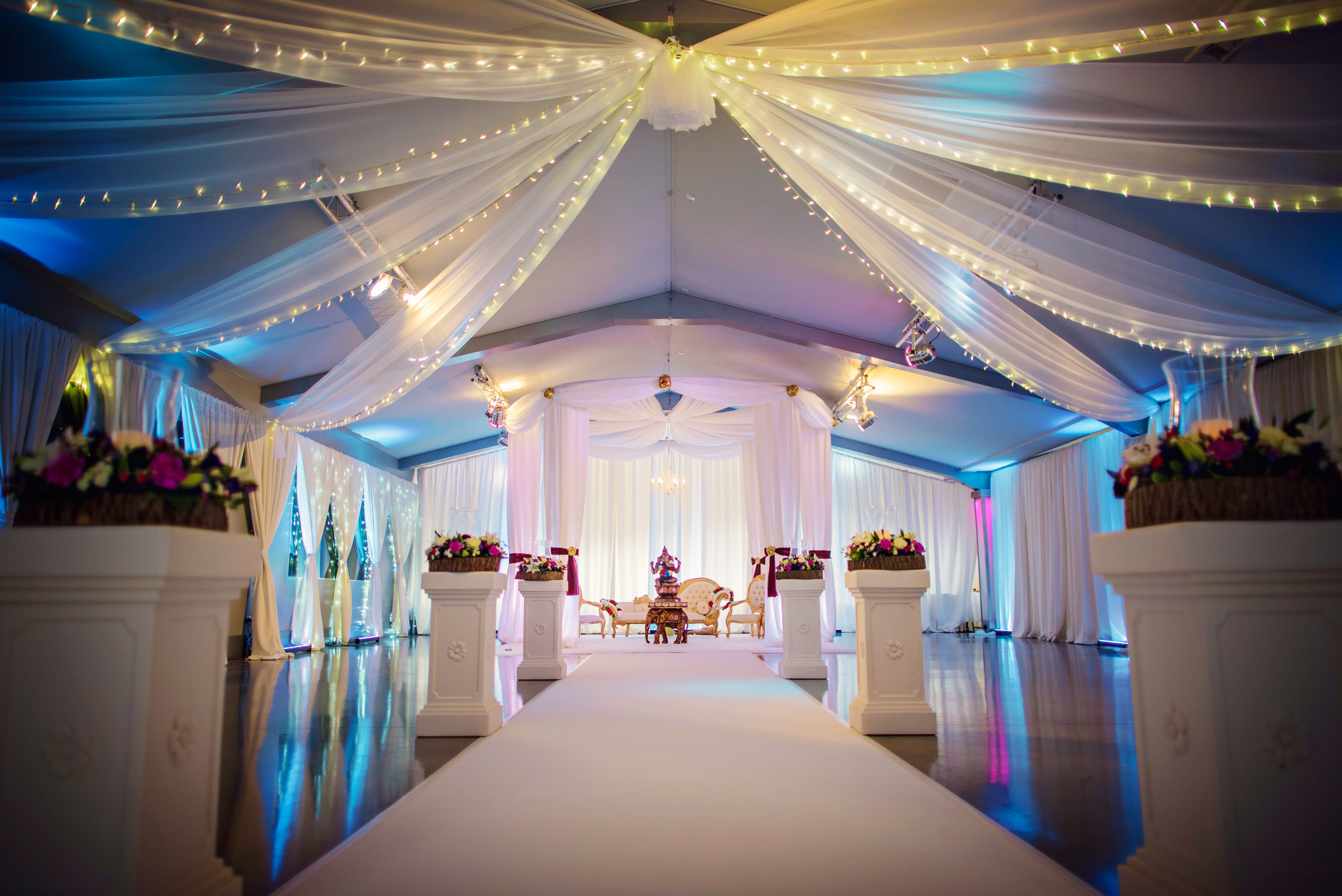 Ladywood Estate wedding decor with wall and ceiling drapes an