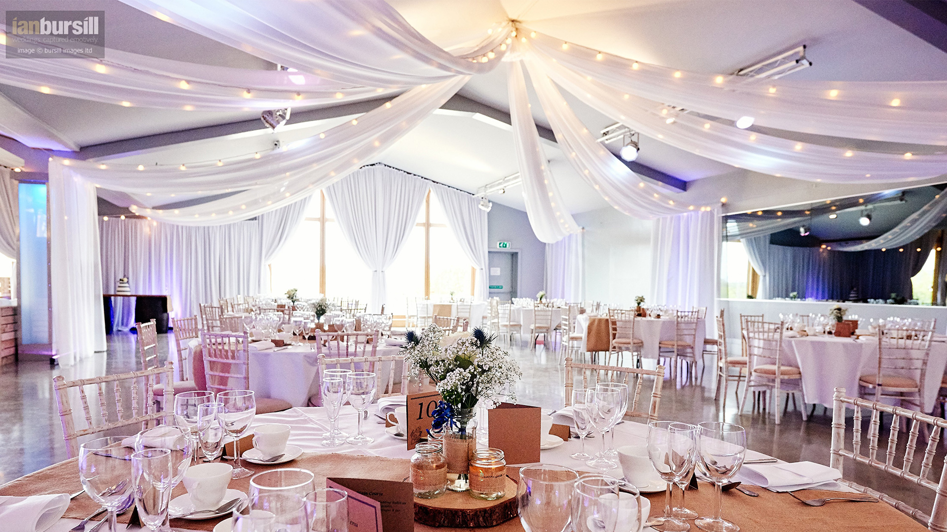More Weddings ceiling drapes with festoon lighting at ladywood estate