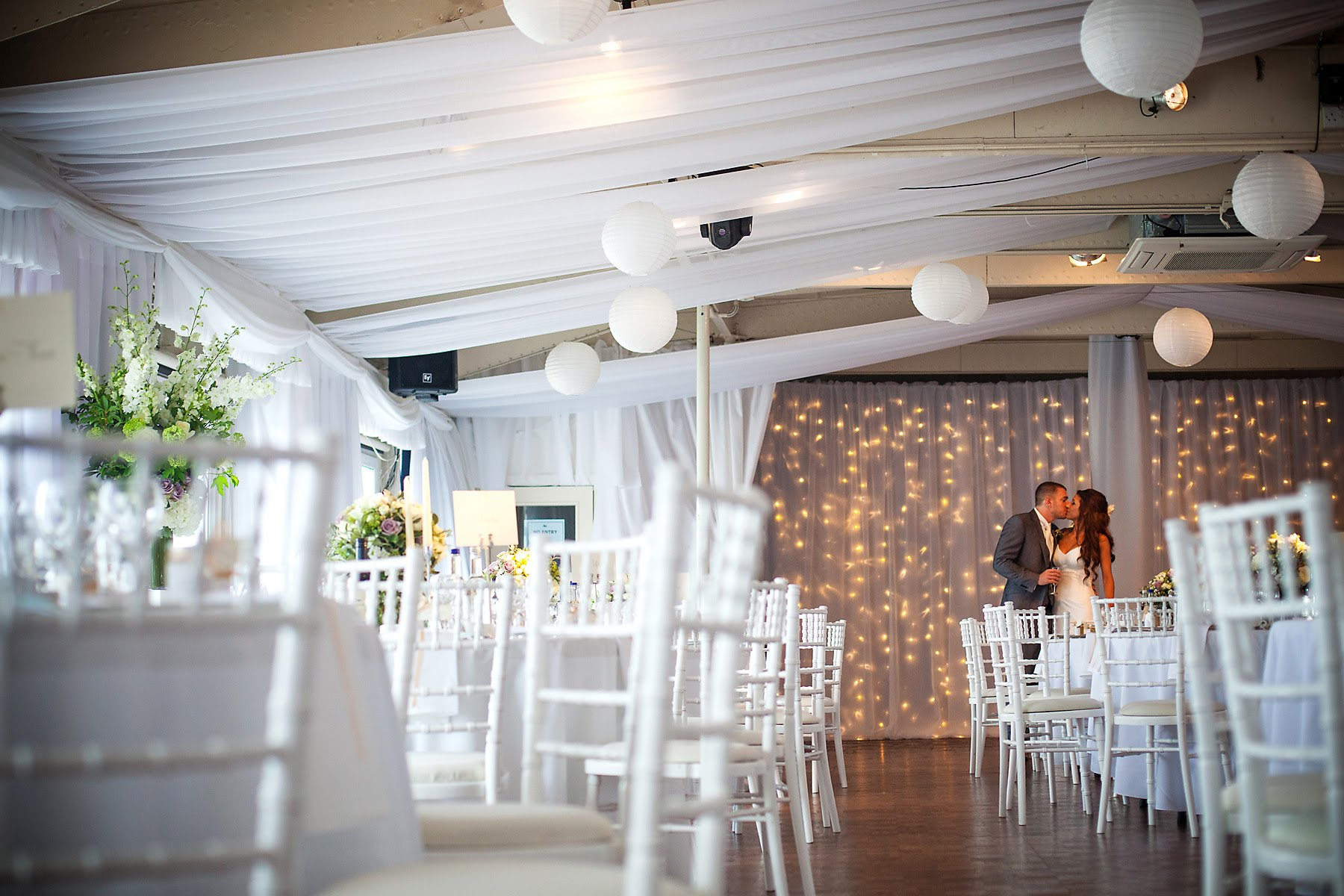 HMS President wedding decor hire with fairy light curtain ceiling drapes and paper lantern ceiling installation