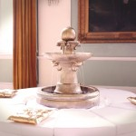 Gold fountain with white circular bed