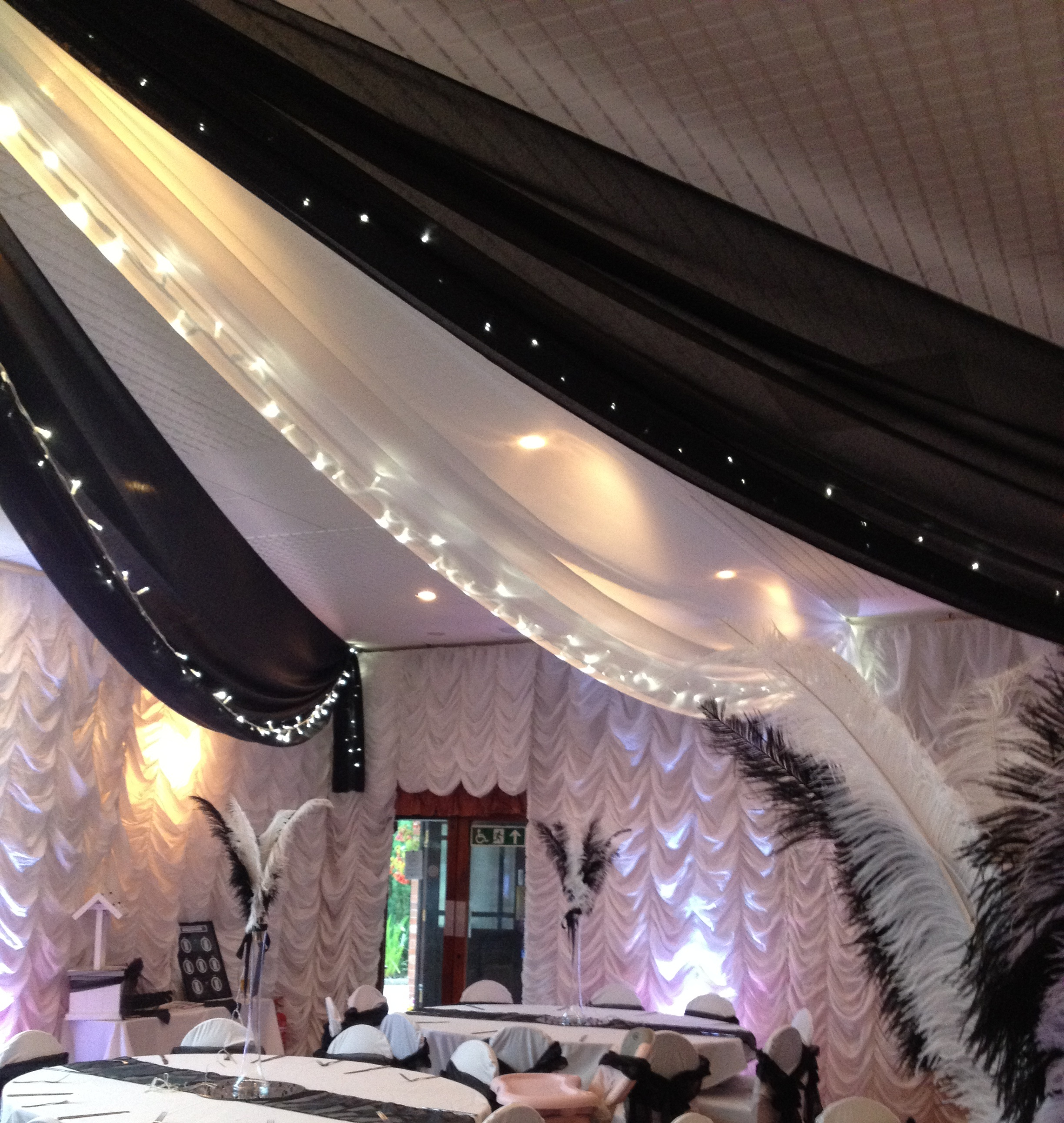 Fabric fairy light canopy more weddings black and white voile fabric ceiling swoops with fairy lights mozeypictures Image collections