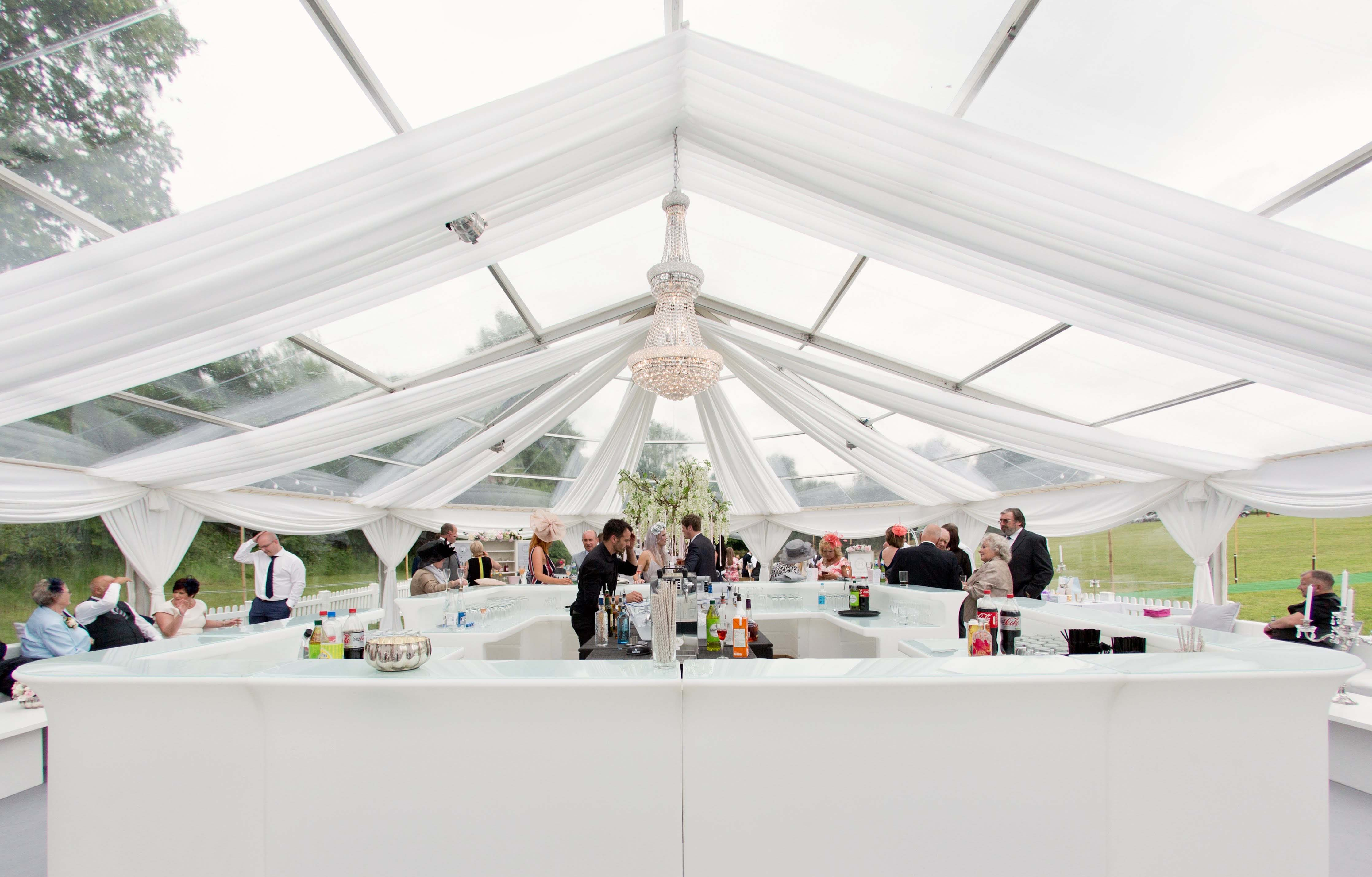 Marquee wedding decor hire with ceiling drapes and crystal empire chandelier