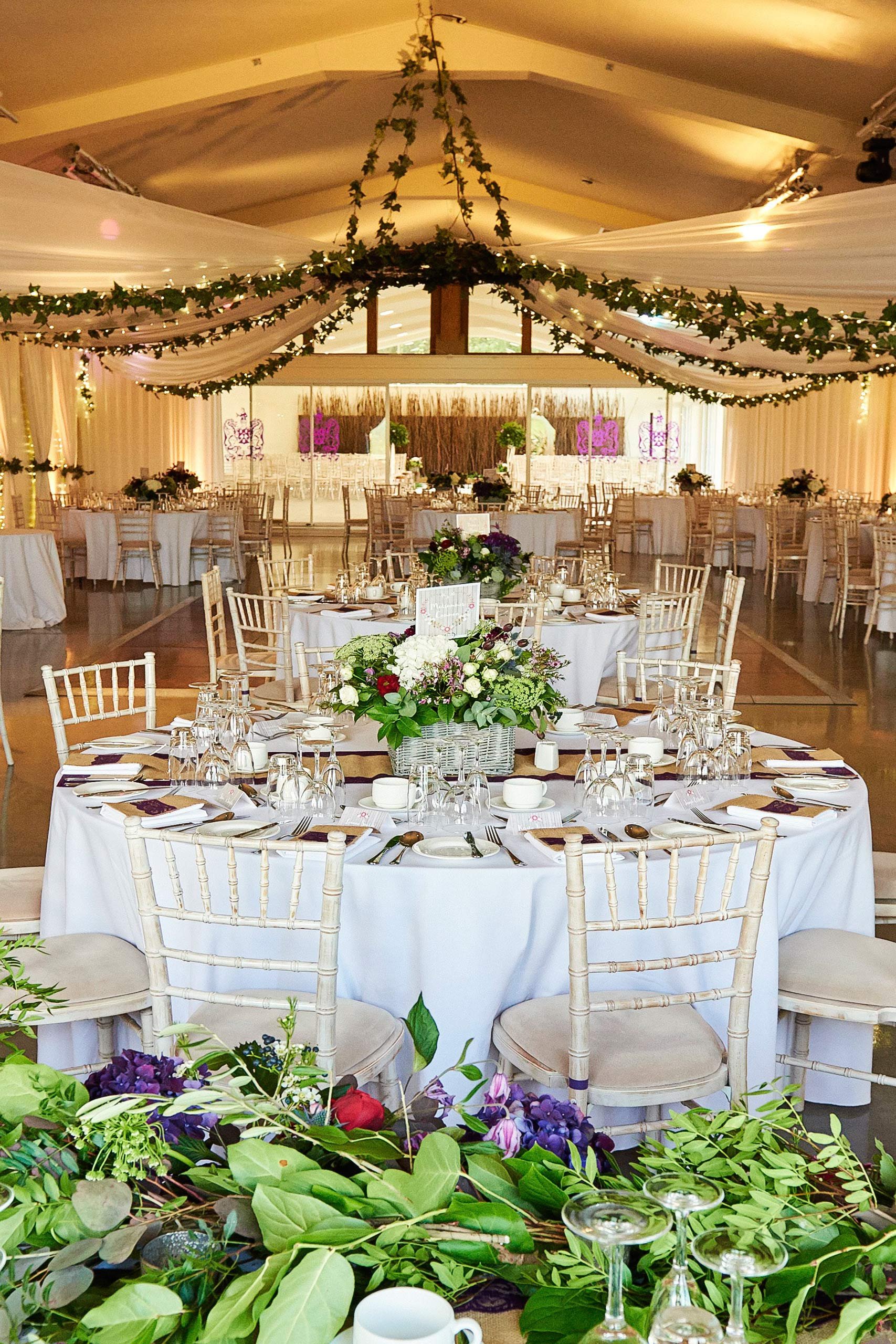 wedding ceiling drapes with fairy lights and foliage garlans at ladywood estates